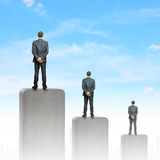 Progress in business. Rear view of three businessman standing on bar Stock Images