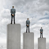 Progress in business. Rear view of three businessman standing on bar Royalty Free Stock Photos