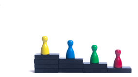 Progress. Figure - Hierarchy - Career steps for the people Stock Photo
