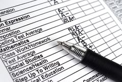 Progress Report. Closeup image of pen resting on a progress report stock photo
