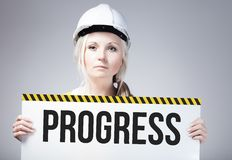 Progress sign held by worker Royalty Free Stock Images