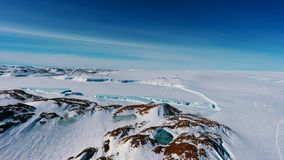 Panorama and just air. View of the ocean, icebergs and polar station, terrain and scenery Antarctic stock images