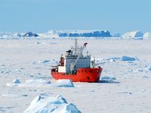 Cargo ship arrives in port for unloading on an ice floe. stock photography