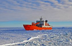 Cargo ship arrives in port for unloading on an ice floe. royalty free stock photography