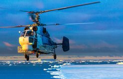 K-32C helicopter Standing on a rocky ground, ready to take off. stock photo