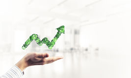 Progressing graph presented in male palms as symbol of success a Stock Photo