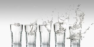 Progression of different splashes on a glass of water. Intensity growth represented with a progression of different splashes on a glass of water Royalty Free Stock Photo