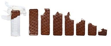 Progression of eaten Chocolate and Vanilla ice cream cookie sand stock photo
