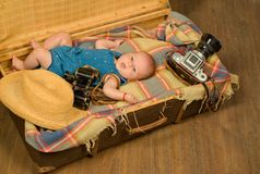 Progressive baby. Family. Child care. Small girl in suitcase. Traveling and adventure. Portrait of happy little child. Childhood happiness. Photo journalist royalty free stock images