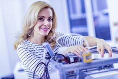 Amazing woman working at her modern project. Progressive innovation. Pretty female expressing positivity while posing on camera Royalty Free Stock Photography