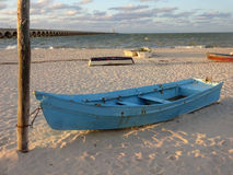 Progresso Beach and Boats at Sunset Stock Photo