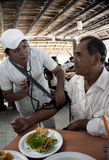 Progresso Mexico January 2015: A medical student checking  blood pressure. Progresso Mexico January 2015: A medical student checks the blood pressure of a Royalty Free Stock Images