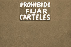 Prohibido fijar carteles written with white paint on wooden boar Royalty Free Stock Images