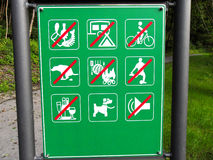 Prohibit restrict sign for all at the forest. No waste, no camping, no bicycle (bike), no waste from dogs, no grill, no football (sport) playing, no alcohol royalty free stock photography