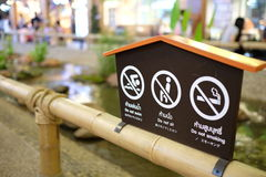 Prohibit sign post. On the bamboo fence Stock Images