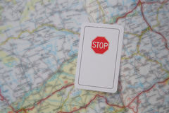 Prohibitary traffic sign. A card with the image of prohibitary traffic sign STOP on the road map Stock Photo