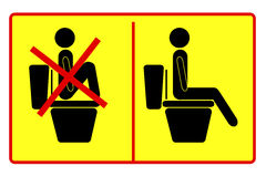 Prohibited and Instruction Sign at Toilet Stock Photos