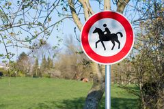 Prohibited sign no horseback riding allowed in northern part of germany stock photo