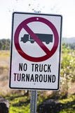 Prohibiting road sign for trucks signed no truck turnaround. Prohibiting traffic sign on a white background which shows a truck in the red circle crossed a red Royalty Free Stock Photography