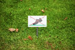 Prohibiting sign on the lawn. On the lawn do not walk.  Stock Image
