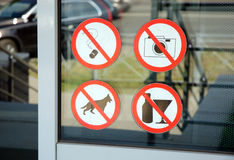 Prohibiting signs. On the wall of the shopping center Royalty Free Stock Photography
