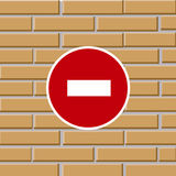 Prohibiting traffic sign on brick wall Royalty Free Stock Photos