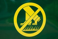 Prohibiting walking on the lawn sign. Prohibiting yellow-green rectangular sign on the lawn does not walk Stock Image