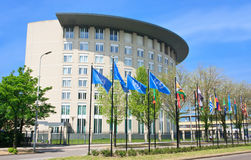 For the Prohibition of Chemical Weapon OPCW. Organization for the Prohibition of Chemical Weapon building behind the United Nations flags commonly called OPCW royalty free stock images