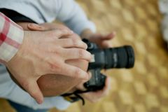 Prohibition of photography. Hand on the photographer& x27;s head royalty free stock image