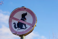 Prohibition sign - dogs must not shit. Prohibition sign dogs must not shit in front of  blue sky Stock Photography