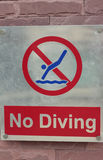 Prohibition sign jump off into the pool on the floor Stock Photo