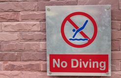 Prohibition sign jump off into the pool on the floor Royalty Free Stock Photos