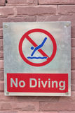 Prohibition sign jump off into the pool on the floor Stock Photography