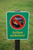 Prohibition sign on the lawn, barbecue is forbidden Stock Images