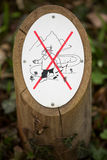Prohibition sign outdoors in forest, don`t cross ! Royalty Free Stock Photography