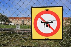 Prohibition sign to fly with drones on the fence. No drone zone. Prohibition sign to fly with drones on the fence. No drone zone Stock Images