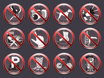 12 prohibition signs. 12 crossed out red prohibition signs on the dark background Royalty Free Stock Image