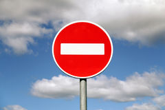 Prohibition traffic sign. Against the sky with clouds Royalty Free Stock Photos