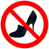Prohibitory road with woman`s shoe Stock Image