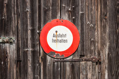 Prohibitory sign in german. Ausfahrt freihalten (keep exit clear. ). Old sign on a wooden door Royalty Free Stock Image