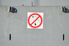 Prohibitory sign on the wall. A sign prohibiting Smoking,hanging on a metal wall Royalty Free Stock Photo