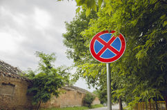 Prohibitory Traffic Parking And Staying Sign. In Front Of Tree Royalty Free Stock Photo
