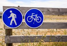 Prohibitory traffic sign. No car entry sign. No motor vehicle. Allow only bicycle and pedestrian on the wooden fence.  Royalty Free Stock Photography