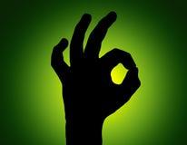 Proietti tutta la mano fine su verde Fotografia Stock