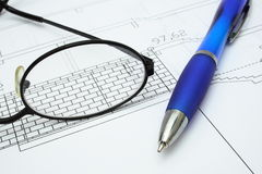Project. A Pencil and eyeglasses on architectural plan Royalty Free Stock Images