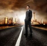 Project. A young businessman on the road of a modern city Royalty Free Stock Photo