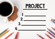 Project blank list. White desk with a pencil and a cup of coffee.  Royalty Free Stock Photos