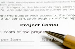 Project Costs with wooden pen stock images