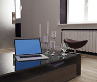 Project design. The composition of the computer candlesticks and glass in the interior Royalty Free Stock Photography