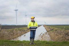 Project developer in a green landscape with windmills Royalty Free Stock Photography